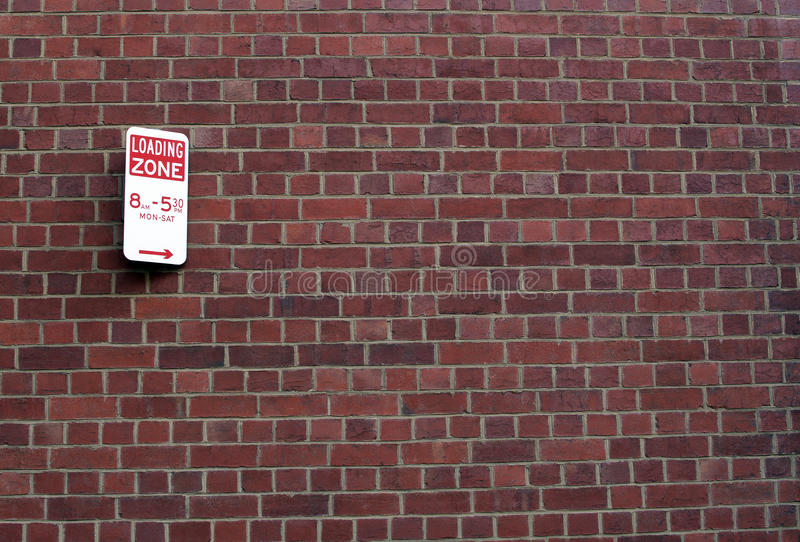 Download Loading Zone Sign On Brick Wall Royalty Free Stock Photography - Image: 27296147