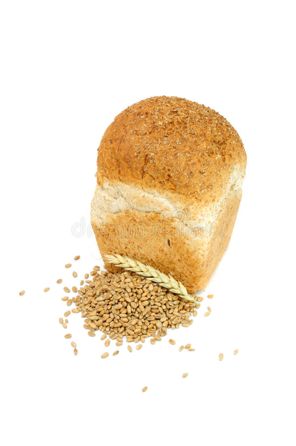 Loaf of Bran Bread with Wheat Grains And Ear royalty free stock photo
