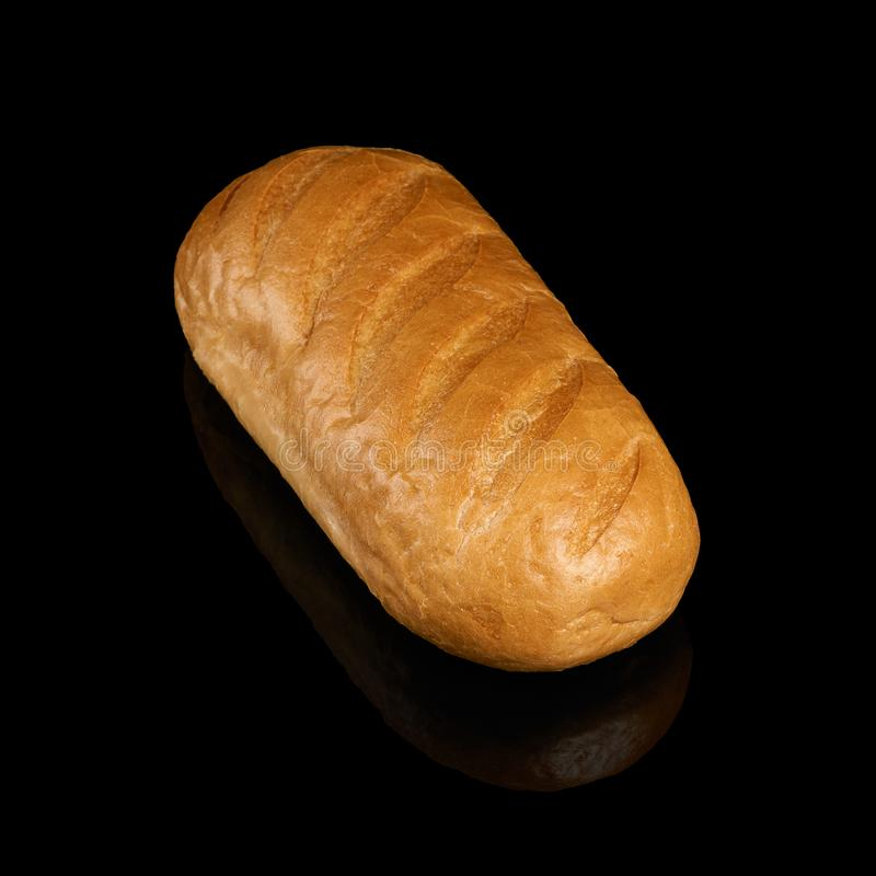 Loaf of bread on black royalty free stock image