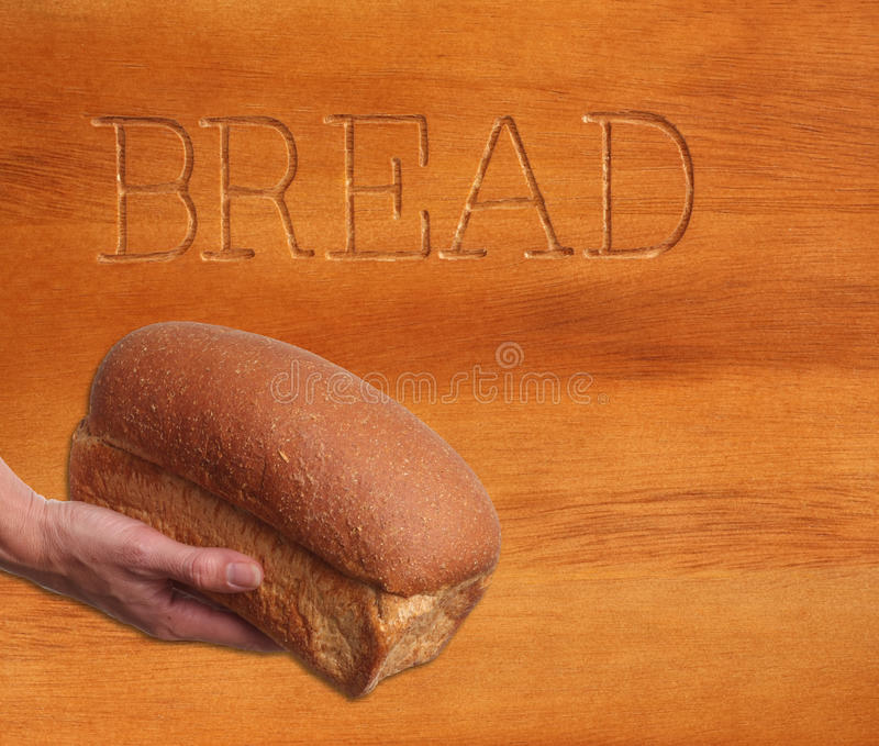 Download Loaf of bread, hand held. stock photo. Image of nutrition - 18483822