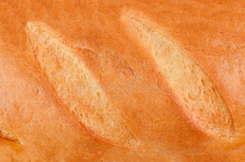 Loaf of fresh crispy bread. Top view. Background stock photo