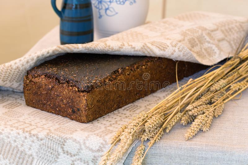 Loaf of home-baked bread wrapped in a linen cloth, traditional Lithuanian cuisine royalty free stock image