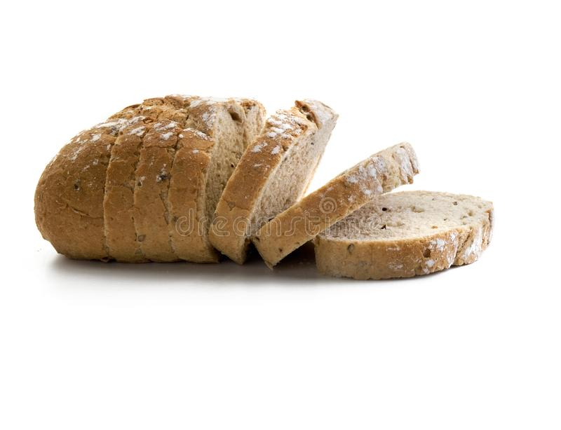 Loaf of homemade whole grain bread cut into slices stock photography