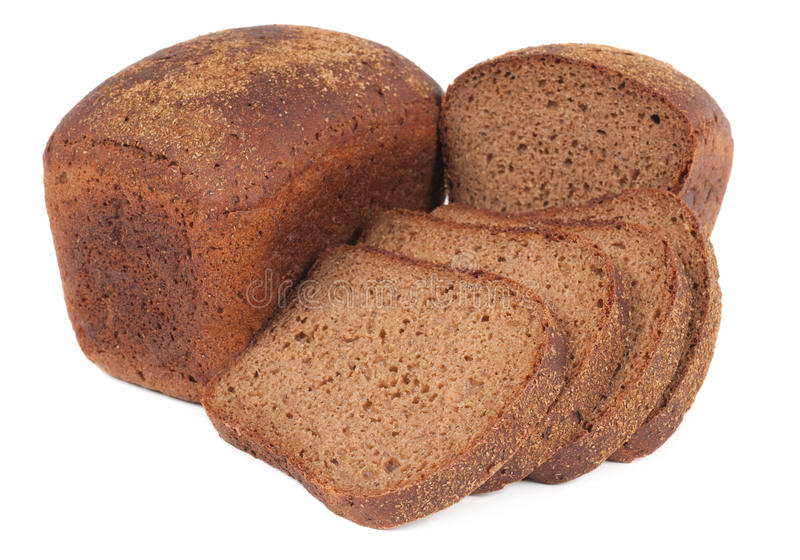 Loaf of rye bread and four slices stock image