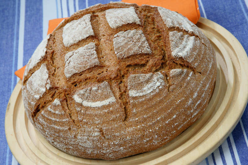 Loaf of rye bread on plate stock images
