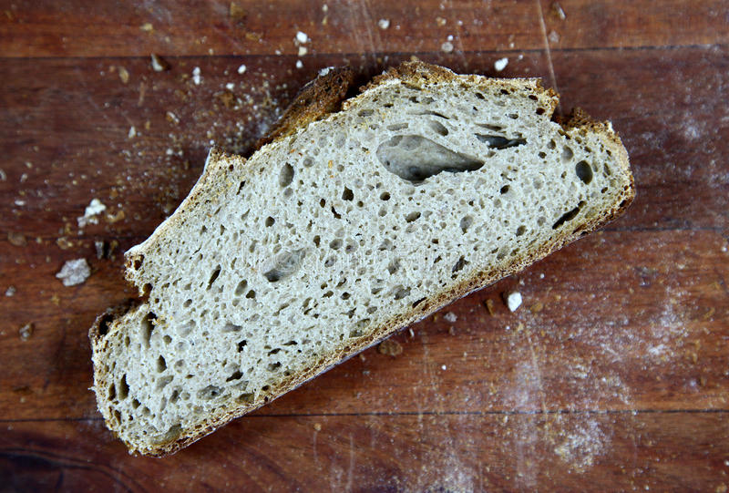 Loaf of sliced whole grain bread stock photo