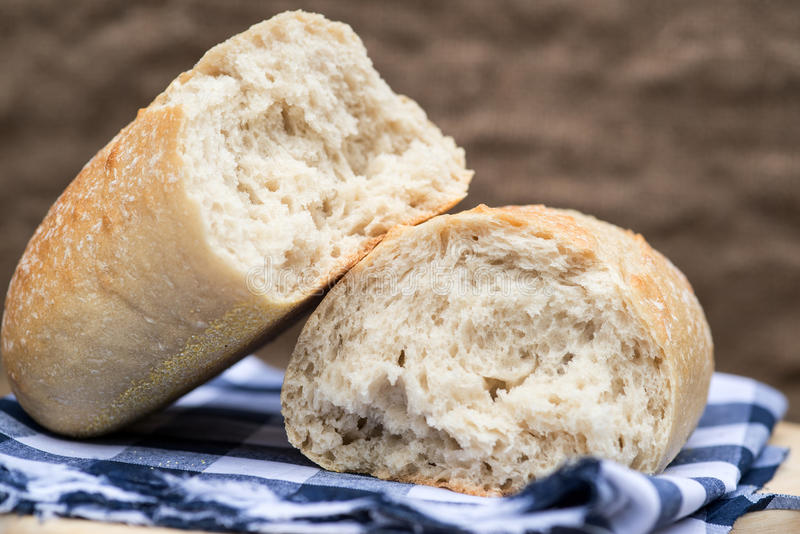 Loaf of sourdough bread in rustic kitchend setting royalty free stock image