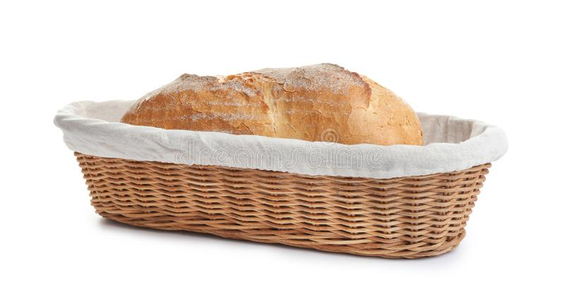 Loaf of tasty fresh bread in wicker on white background. Loaf of tasty fresh bread in wicker basket on white background stock photos