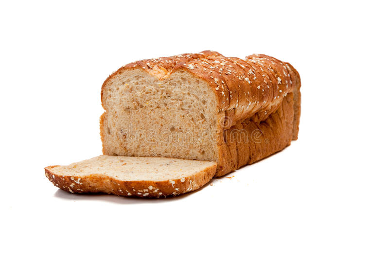 A loaf of whole grain bread on white stock images