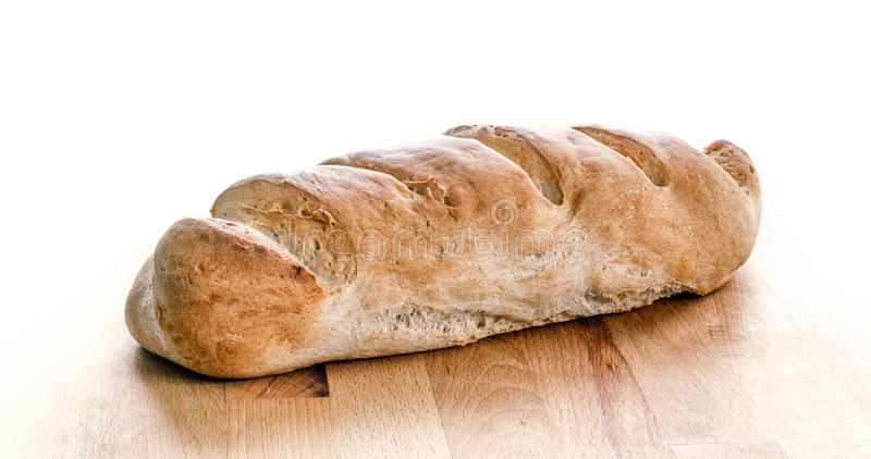 Loaf of whole wheat bread isolated on white. Home made organic c stock photos