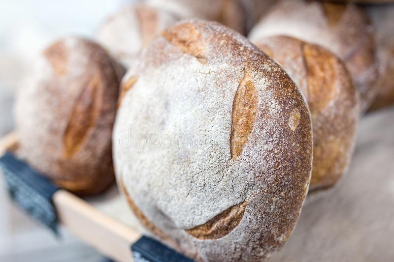 Loafs of warm tasty freshly baked bread in a bakery shop or market stock photos