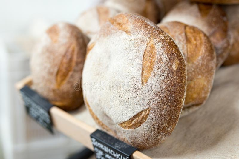 Loafs of warm tasty freshly baked bread in a bakery shop or market stock photography