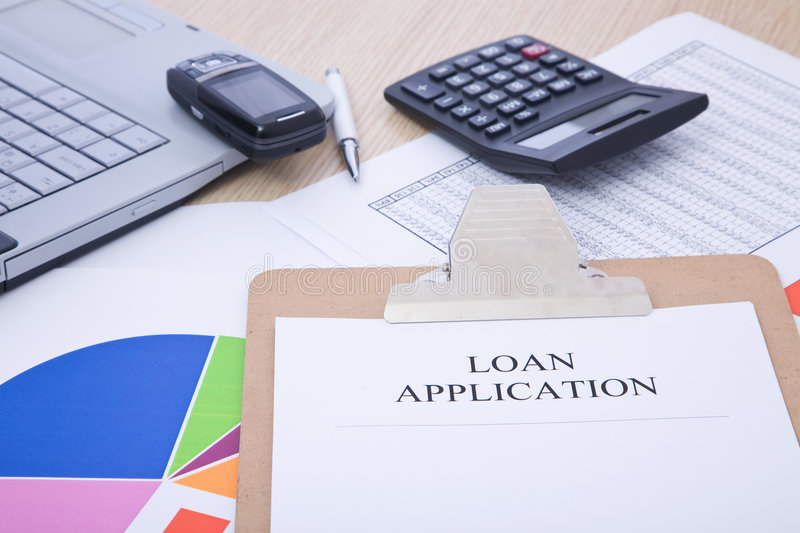 Loan application. Form on office desk with accessories stock photography