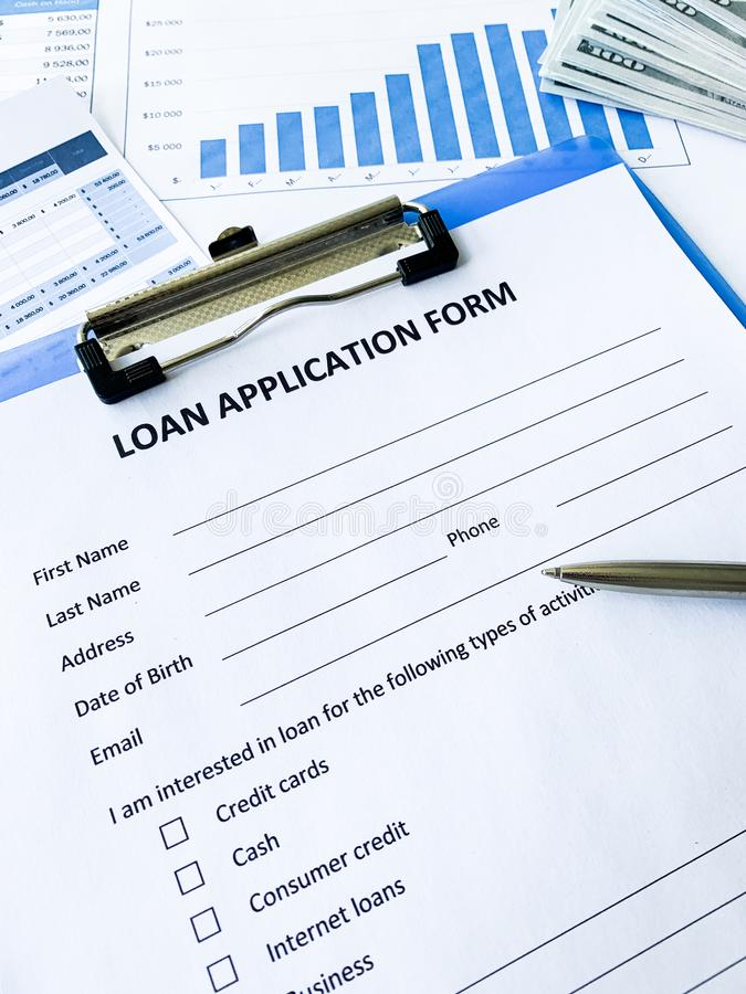Loan application form document with graph on table royalty free stock photo