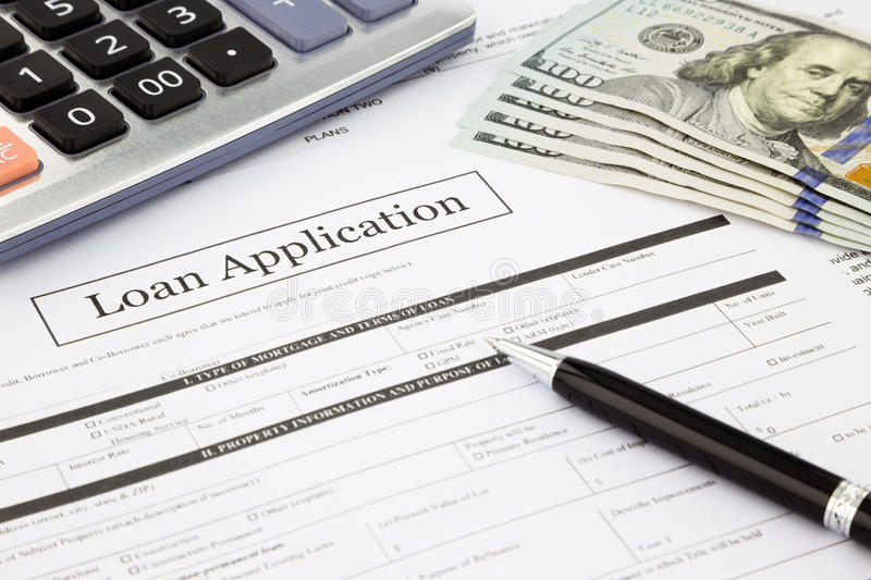 Loan application form and dollar banknotes. Closeup loan application form and dollar banknotes, business and finance concept and idea stock photography