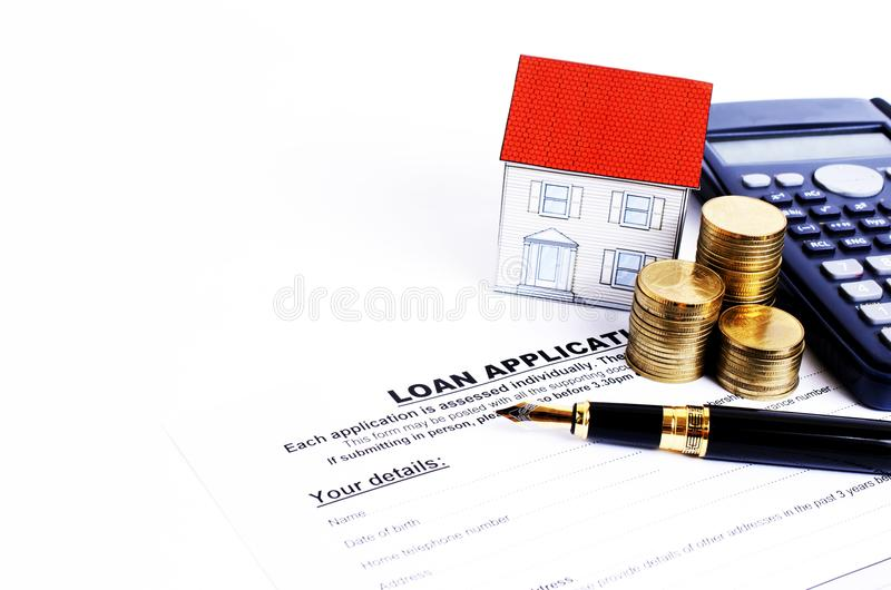 Loan application form and fountain pen and calculator and coins. Stack and paper house royalty free stock image