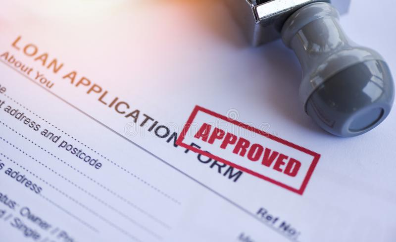 Loan approval / financial loan application form for lender and borrower for help investment bank estate. Concept stock image