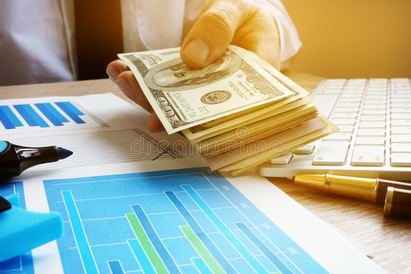 Loan concept. Businessman holding stack of dollar bills. stock photography
