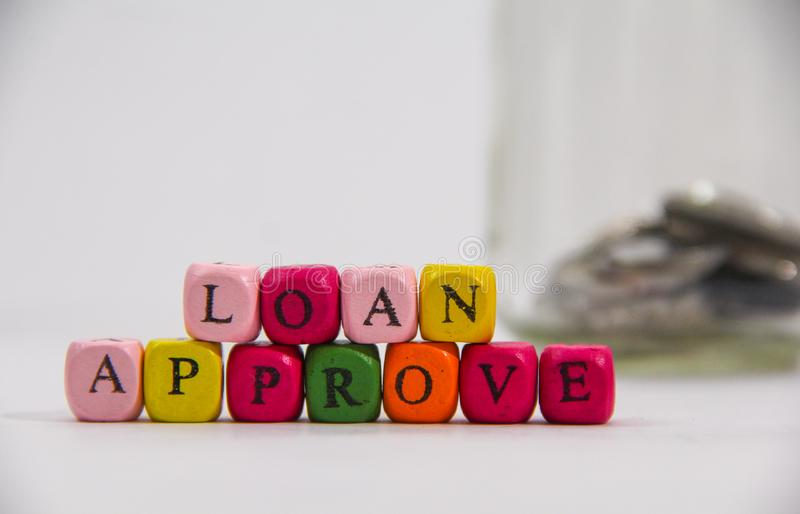 Loan Approve with colourful alphabet on white background stock image