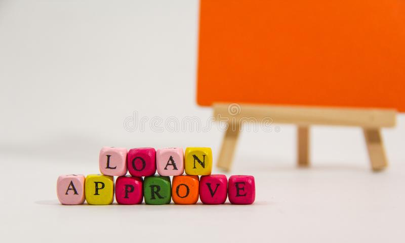 Loan Approve with colourful alphabet on white background royalty free stock images