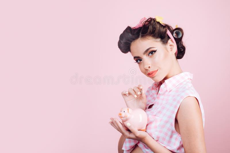 Loan. Money. Housewife. pin up woman with trendy makeup. pinup girl with fashion hair. retro woman with moneybox. pretty stock images