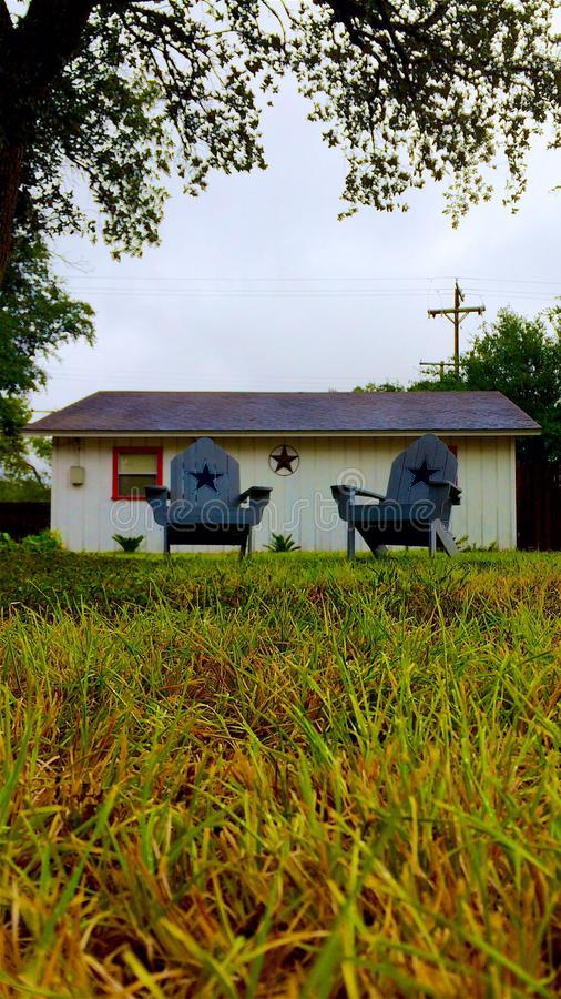 Loan Star State. Chairs loan star grass home pleasant Texas royalty free stock photography