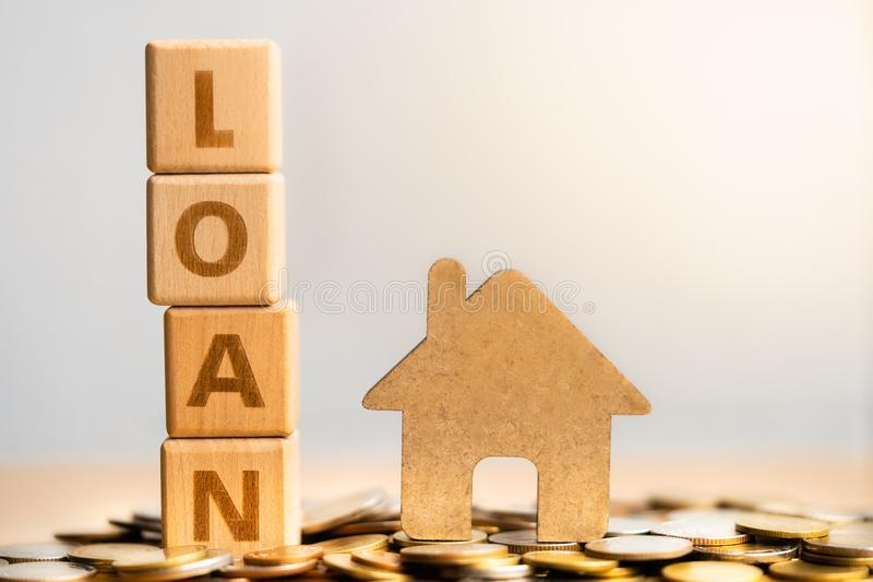 Loan on wooden surface. house model. stock images