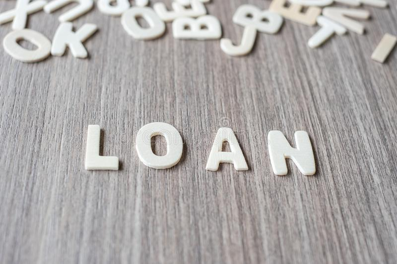 LOAN word of wooden alphabet letters. Business and Idea. Concept royalty free stock images