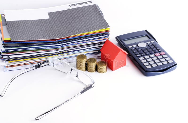 Loans concept with Bill payment and calculator and coins and house paper and eyeglsses stock photography