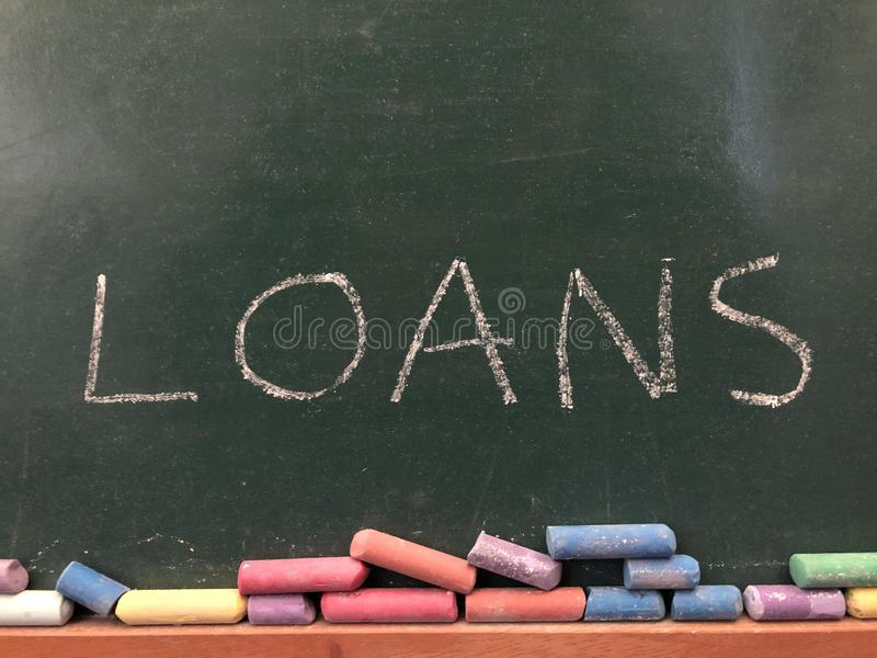 The word Loans written in chalk royalty free stock image