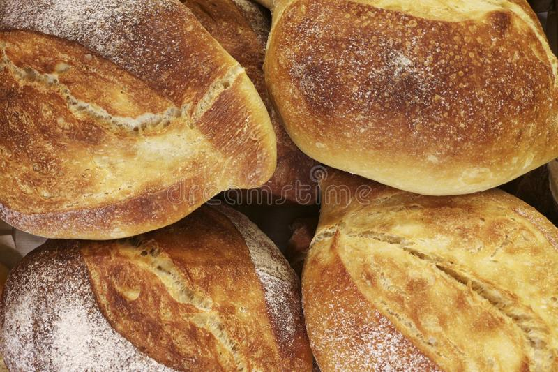 Loaves of bread in a bakery. Variety of breads displayed on shelves in bakery royalty free stock image