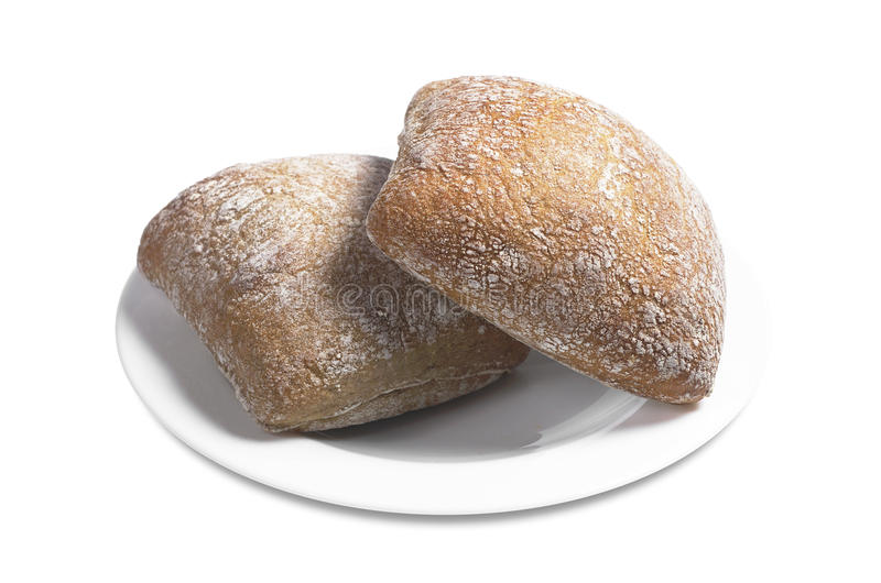 Loaves of bread ciabatta. Small loaves of bread ciabatta in plate on white background royalty free stock photos