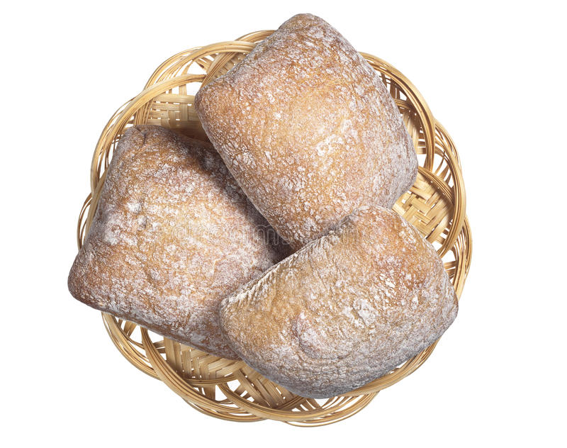 Loaves of bread ciabatta. Small loaves of bread ciabatta in wicker wooden plate isolated on white background, top view stock photo