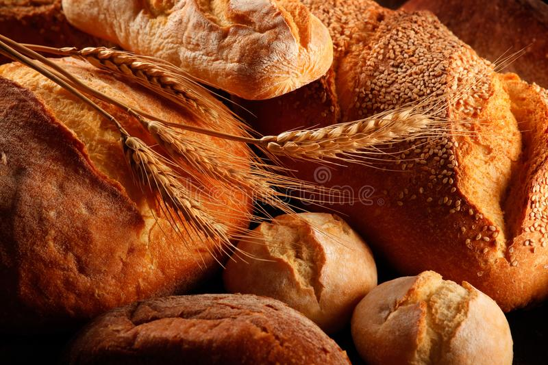 Loaves of bread and ears of wheat royalty free stock photos