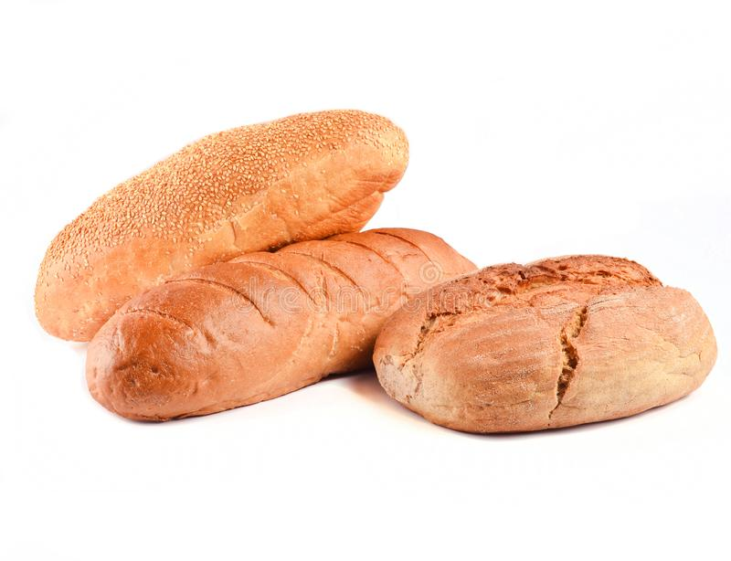 Loaves of bread isolated on white background. Wheat, rye, bread with sesame seeds stock image