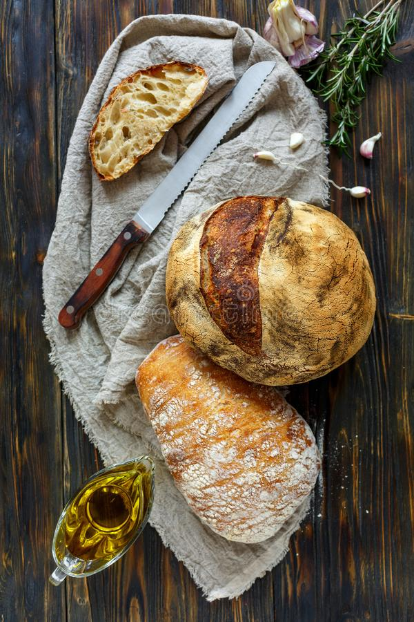 Homemade freshly baked bread on linen cloth. royalty free stock photo