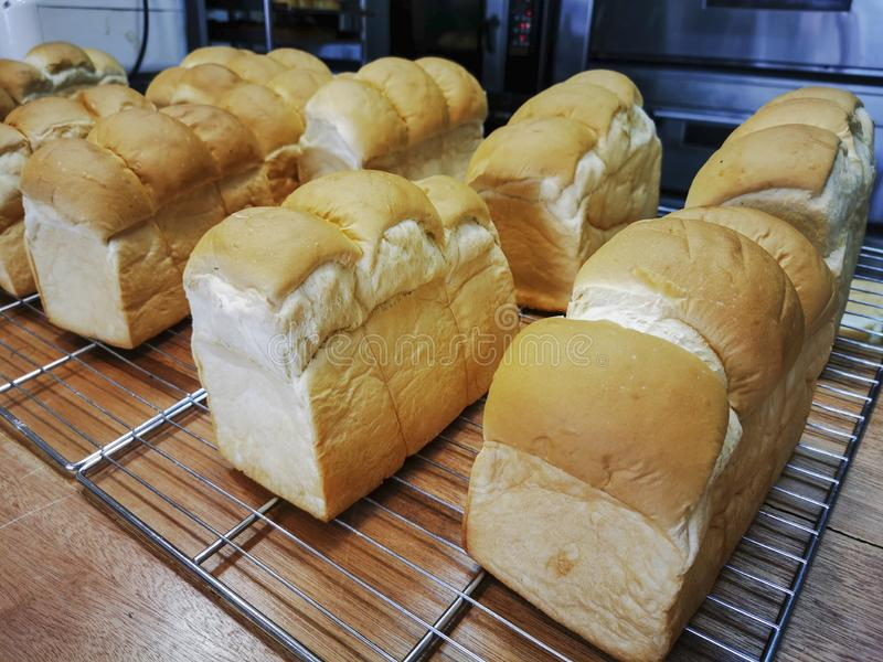 Loaves of hot fresh bread on the counter ready for sale stock photography
