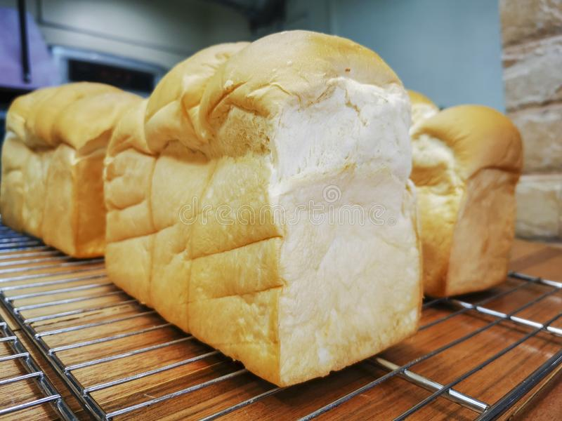 Loaves of hot fresh bread on the counter ready for sale stock photo
