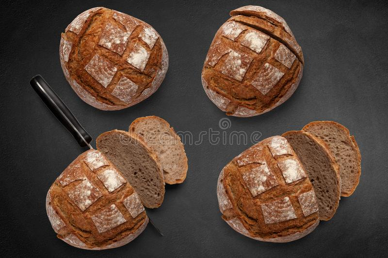 A loaves of rye bread on a gray background royalty free stock image