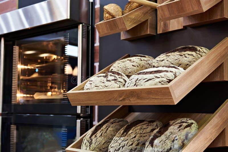 Loaves of rye bread on shelf in bakery stock photos