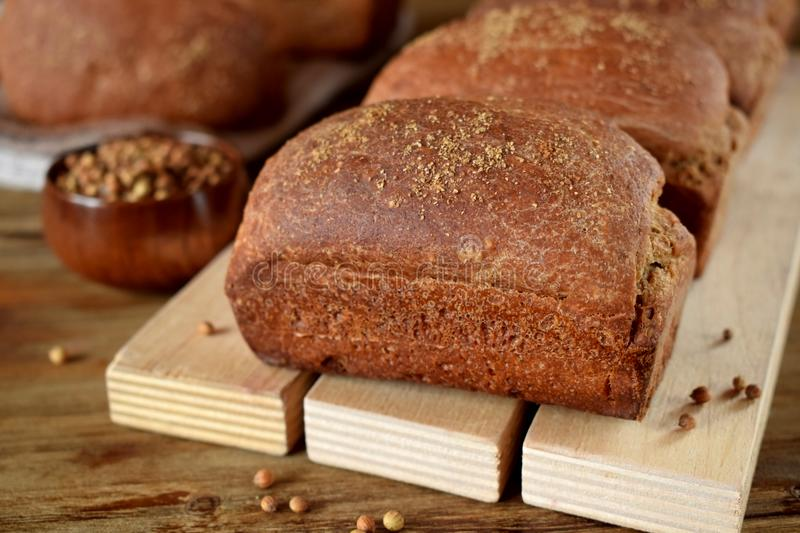 Loaves of rye bread sprinkled with coriander stock image
