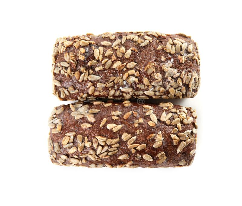 Loaves of rye bread with sunflower seeds isolated on white stock photo