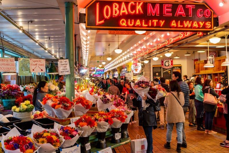 Loback mięsa Co Neonowy znak i kwiaty zdjęcia royalty free