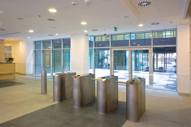 Lobby entrance with turnstile stock photos