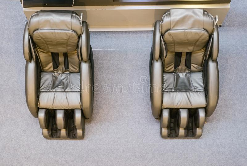 Lobby equip with massage sofas for guest.shadow on the floor and reflection on the mirror.i stock images