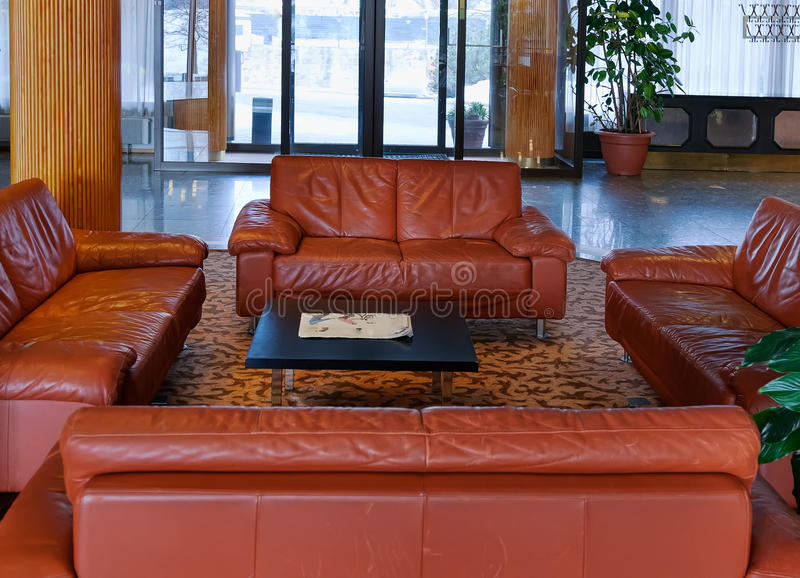 Lobby with leather sofas. Luxurious leather sofas in the lobby royalty free stock photography