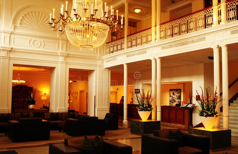 The lobby of the luxury Belle Epoque hotel Kempinski des Baign i. Switzerland: The spacious lobby of the luxury hotel Kempinski des Baigns in St. Moritz in the royalty free stock photos