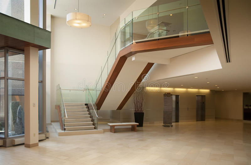 Lobby in a modern building. Modern office building lobby in marble, glass and mahogany royalty free stock photo