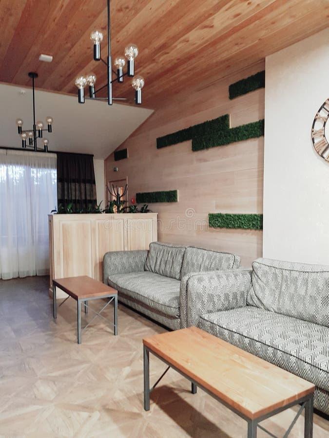 Lobby in modern hotel in ski resort Bukovel. Beautiful  hotel  ski resort  chalets  bukovel carpathian s  carpathians ukraine amazing winter wood   wooden royalty free stock photo