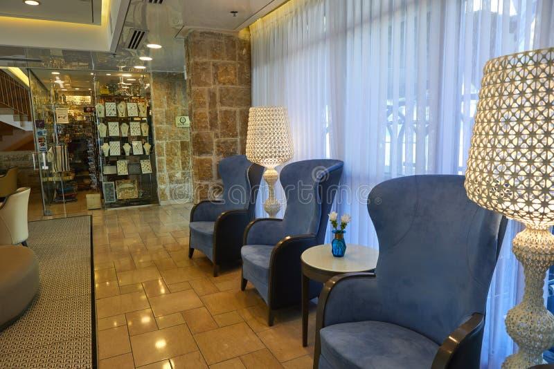 Lobby of Yehuda Hotel in Jerusalem. Jerusalem, Israel - July 10, 2019: Lobby of Yehuda Hotel in Jerusalem, desk, business, reception, room, people, work, service stock image